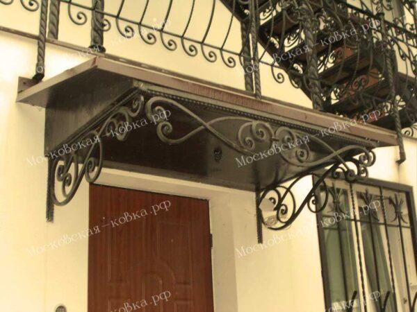 Кованый козырек в стиле решеток на окнах № 123